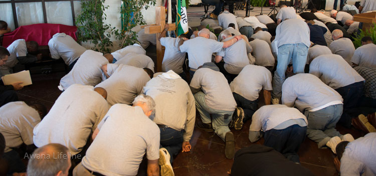 Malachi Dads—inmates of Angola prison—on their knees before God