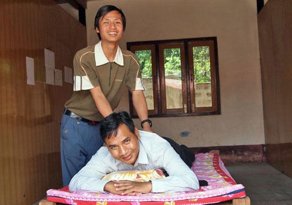 cwdf-khamh-on-massage-table
