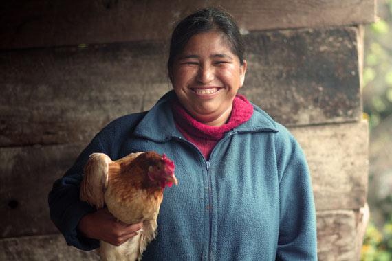 widow-holding-chicken