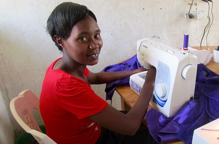 Elizabeth sewing a dress