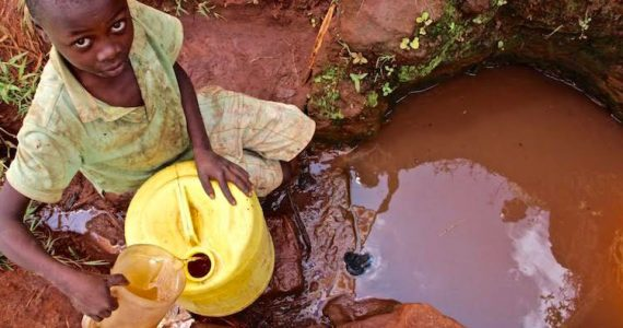Picture of boy gathering water