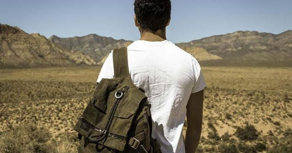 young man with backpack fleeing pakistan