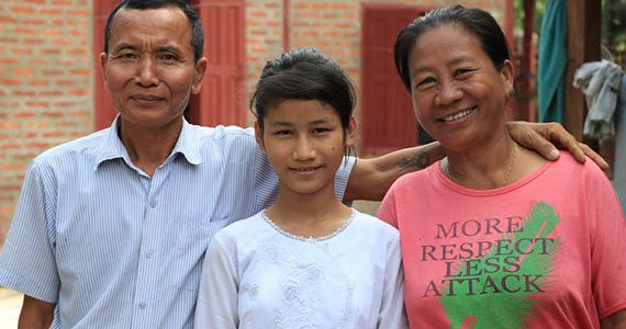 picture of child in myanmar with uncle and aunt, after being taken out of orphanage