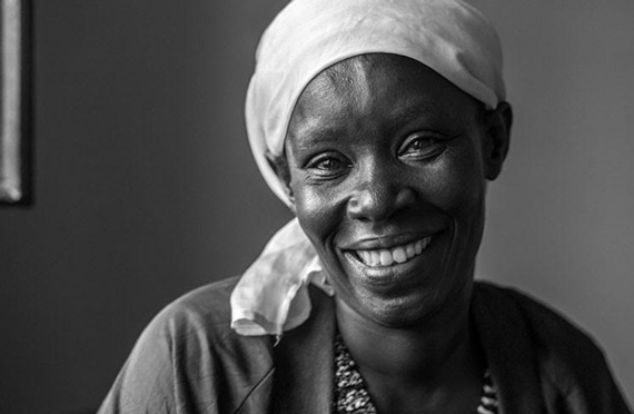 picture of Rebecca of Rwanda smiling, teary-eyed