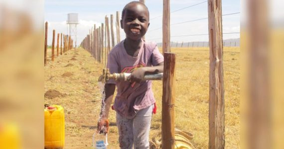 Little child in Kenya with clean drinking water