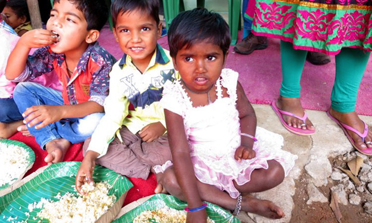 Children at a leprosy colony in Hyderabad, India eating