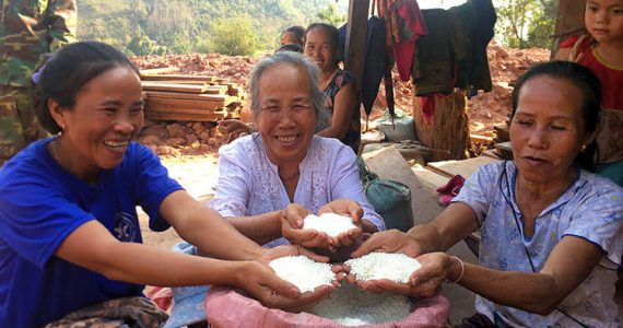 Women in Laos with rice bags