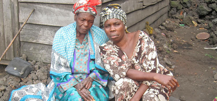 Picture of Monique with leprosy victim in DR Congo