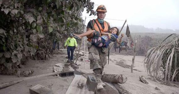Picture of child being rescued after earthquake in Guatemala