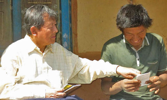 Picture of missionary sharing gospel tract and new testament