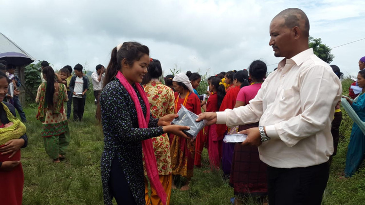 Picture of Tibetan young woman receiving her own copy of God's Word