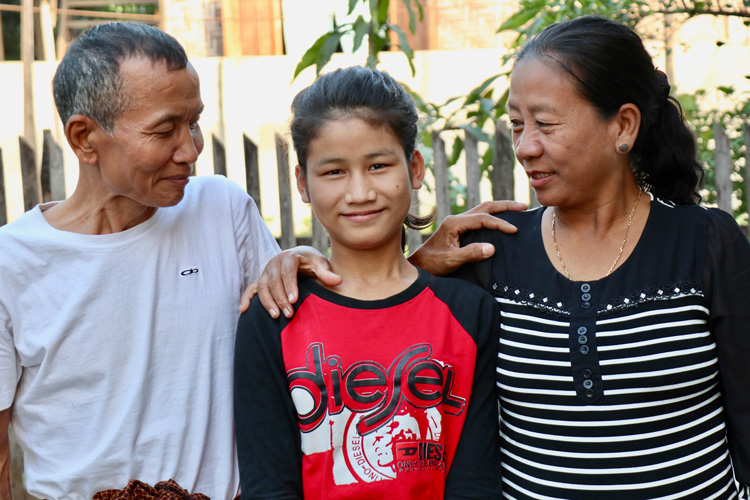 Picture of former orphan reconciled with family