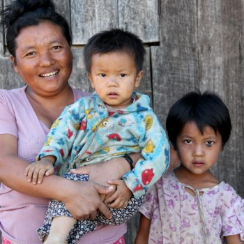 Mother with her two children after reunification process