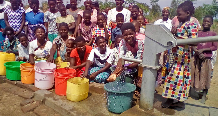 Picture of villagers in Malawi with clean water
