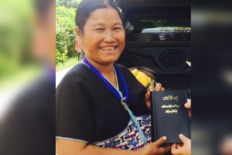 Woman with gift of Bible