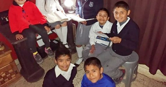 Picture of children in Mexico with electricity working
