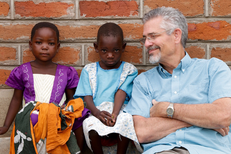 Picture of David with children in Malawi