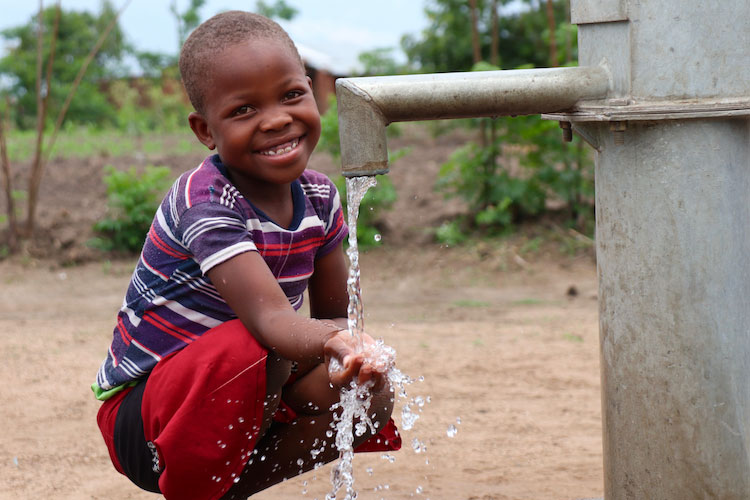 Picture of little girl drinking clean water
