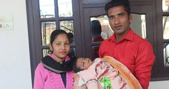 Picture of family in India with miracle baby