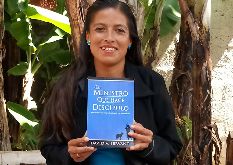 Paz Islas Rufino from Mexico with Disciple-Making Minister book