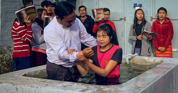 Picture of Mo Sai being baptized