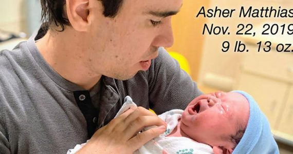 Picture of Orphan's Tear Ministry Director Stephen Servant with newborn son, Asher