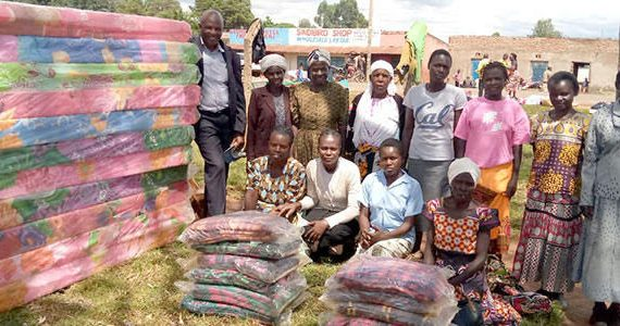 Pictures of widows in Kenya receiving blankets and mattresses