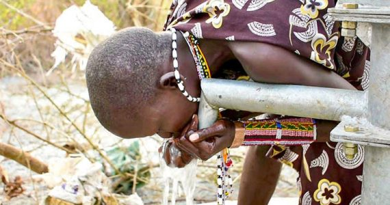 Picture of child in South Sudan drinking clean water