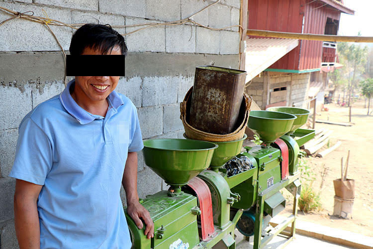 Picture of micro-borrower with rice hulling machine