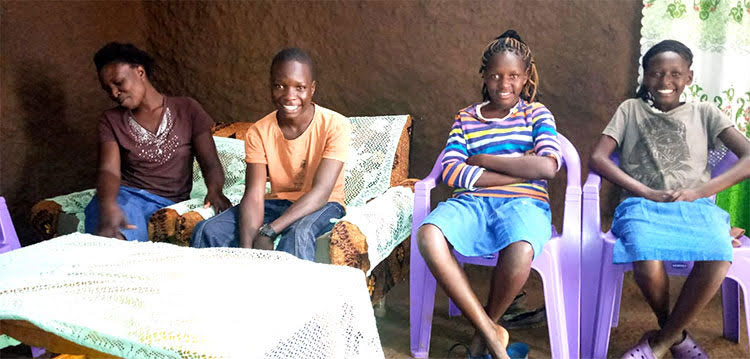 Picture of Kenyan widow and her family in new house