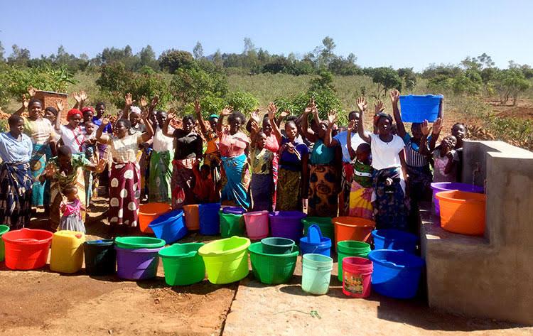 Villagers in Malawi enjoying clean water
