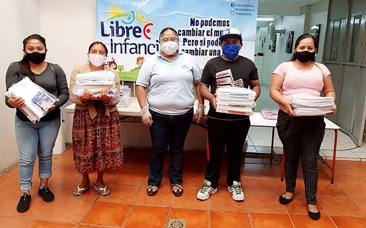 Picture of parents in Guatemala receiving educational packets