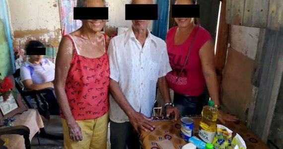Picture of family receiving food relief